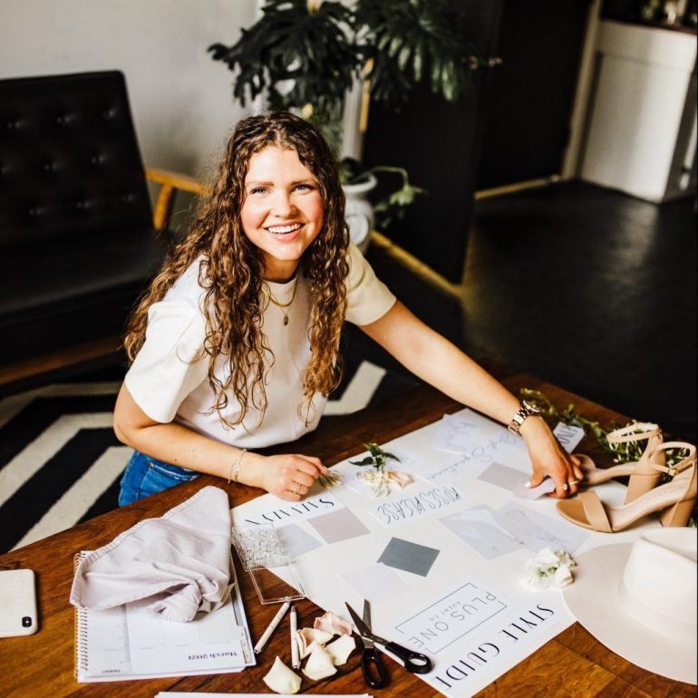 wedding planner looks at vision board during her lifestyle branding session