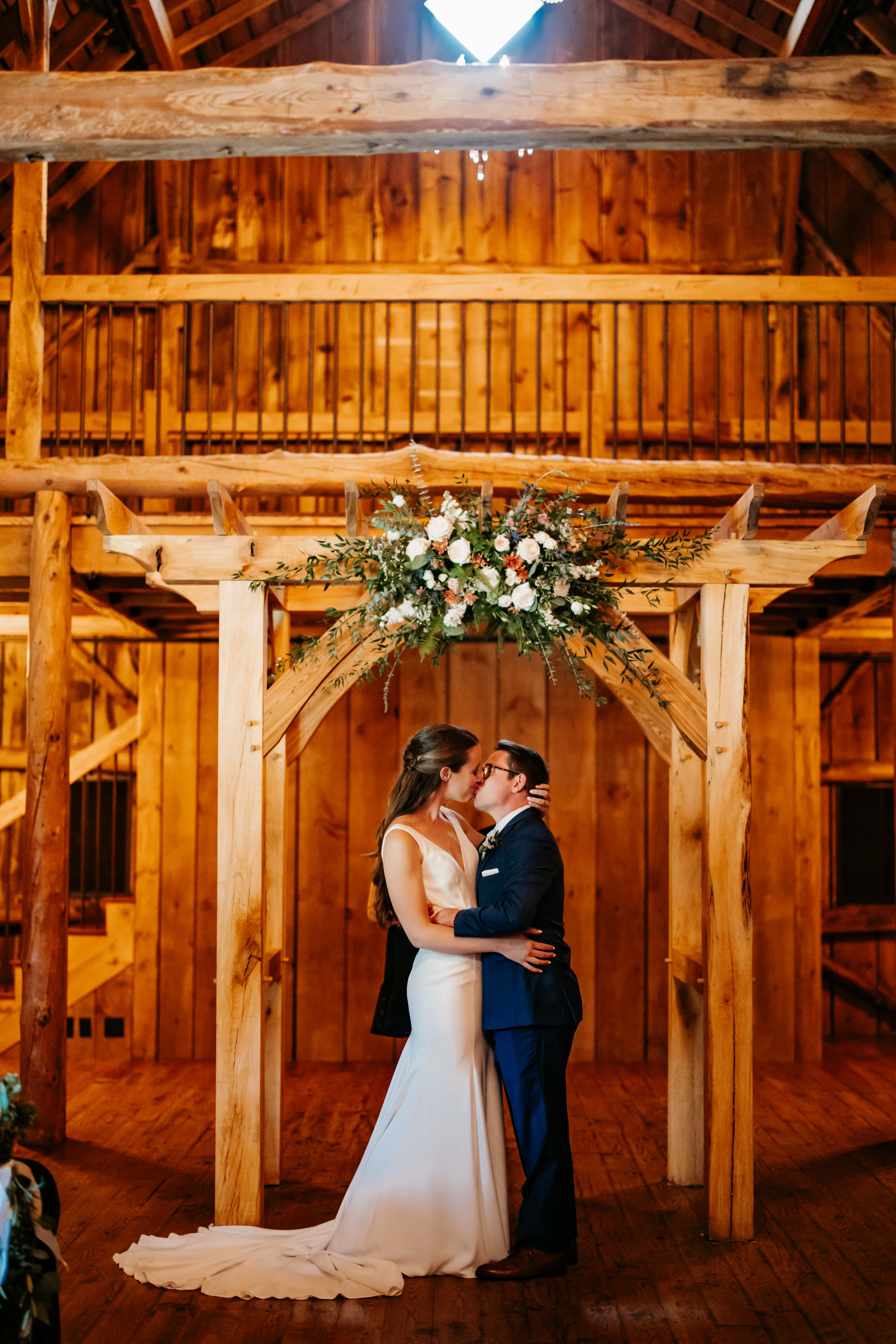 Bride and Groom have their first kiss at their Rolling Ridge wedding
