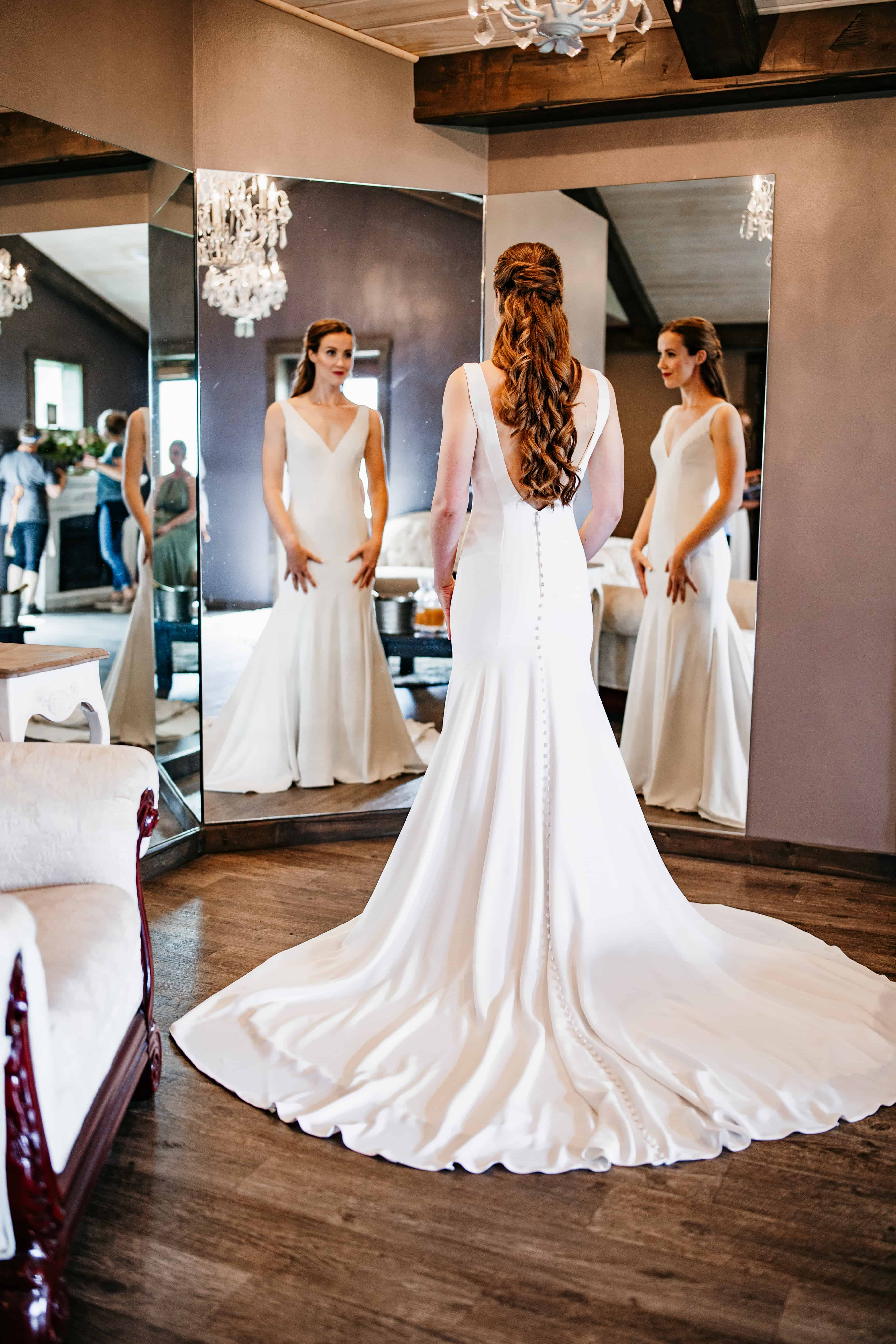 Bride gets ready in mirrors before her Rolling Ridge Wedding