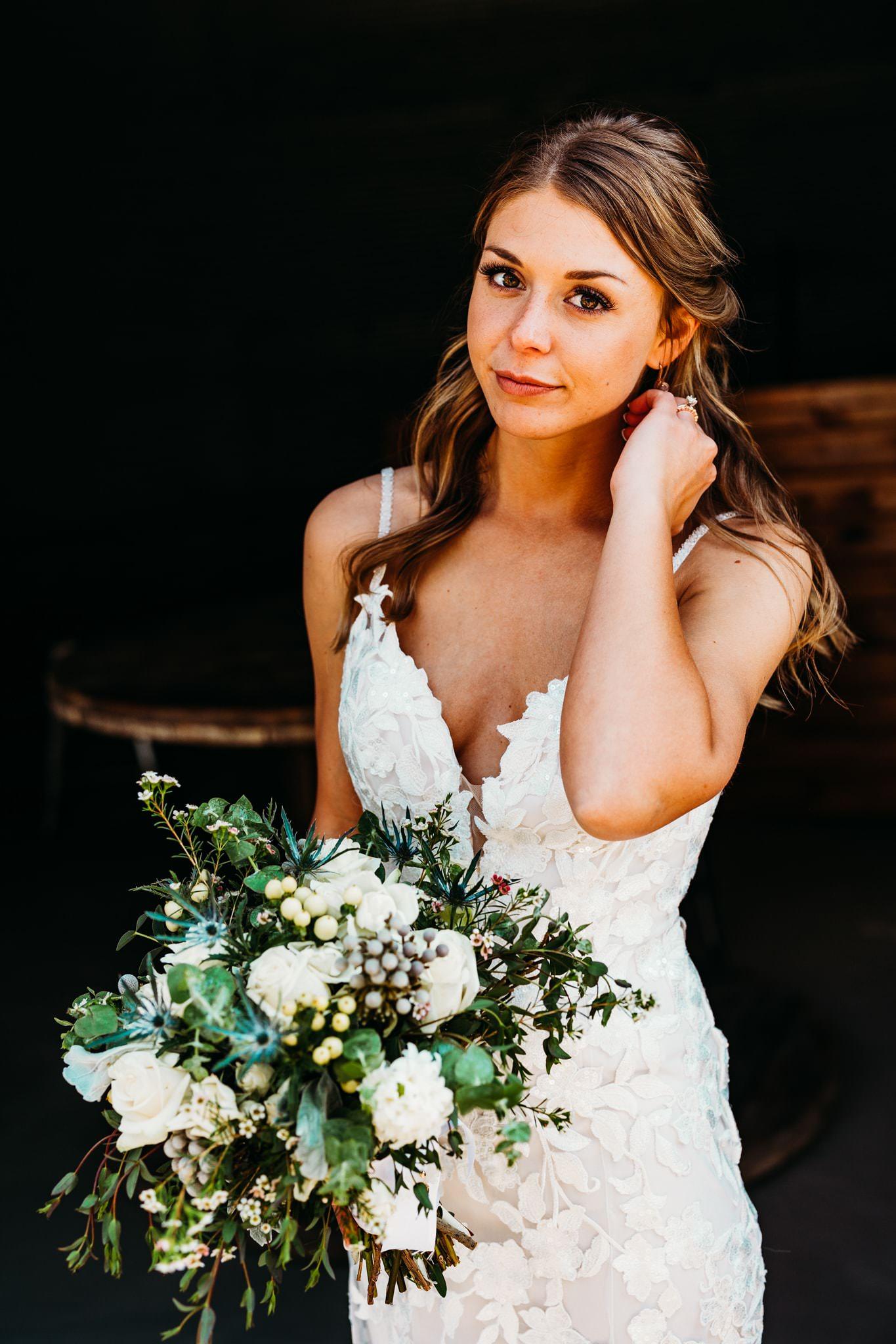 Bride stares into the camera at her schroeder farm wedding