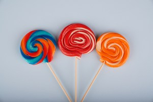 Assorted round lollipops on blue background