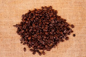 Roasted whole coffee beans on sack