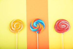 Sweet candies on colorful background