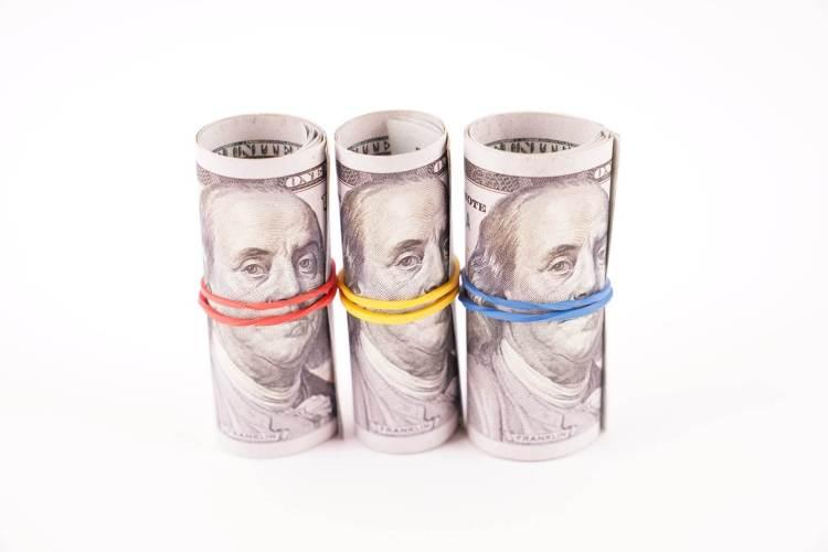 Rolls of 100 dollar bills stock image