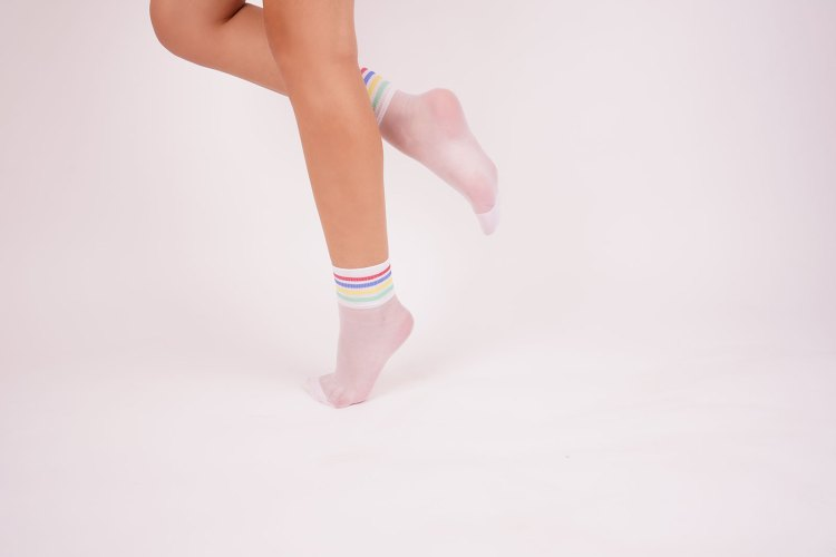 Woman standing in white socks