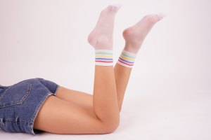 Young female wears rainbow white socks