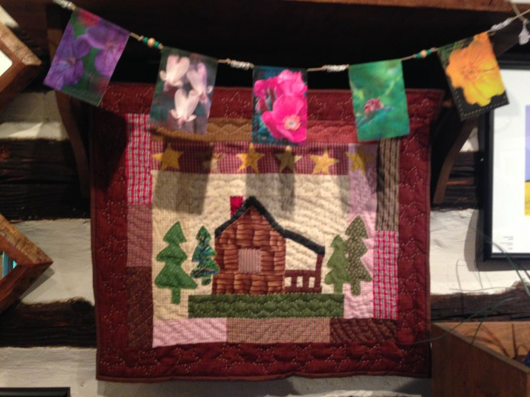 The beautiful quilting of Lucille Seskes, accompanied by the photo on fiber banners by Diane Seskes, gallery owner