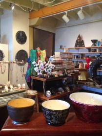 a view from behind a display of Allen's ceramics