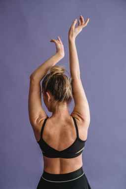graceful strong woman showing slender arms