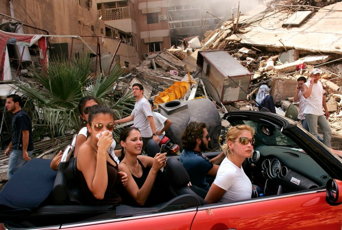 "9. Spencer Platt, ""Young Lebanese Driving Through Devastated Neighborhood of South Beirut"", World Press Photo of the Year 2006."
