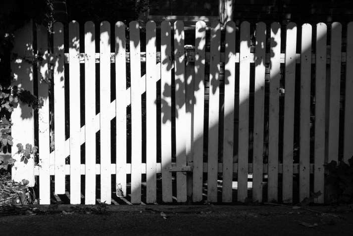 Picket Fence with Afternoon Shadows, Franklin Street. Nikon D200, 18-70 AF-S DX @40mm, ISO 100, f/8, 1/200 sec