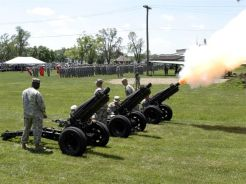 A cannon salute is fired at the change of command ceremony