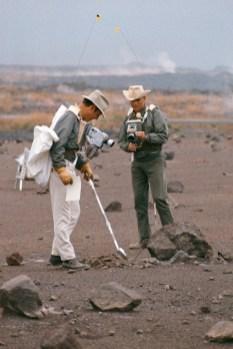 Astronauts-James-A.-Lovell-Jr.-left-commander-and-Fred-W.-Haise-Jr.-lunar-module-pilot-carry-out-a-simulation-of-a-lunar-traverse-WC
