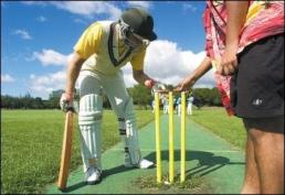 Batsman James Le Marchant Lawrence positions a wooden bail atop the stumps to form the wicket-(honolulucricketclub-org)
