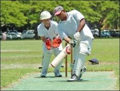 Batter Bishnu Ramsarran and wicketkeeper Owen O'Callaghan keep their eyes on the ball during play at Kapiolani Park-(honolulucricketclub-org)