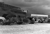 Cars that were strafed by Japanese aircraft pictured at Naval Air Station (NAS) Kaneohe, Hawaii