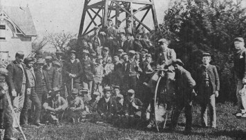 David Kawananakoa, against bicycle wheel, Thomas Cummins, seated center front, at St. Matthews Military Academy, c. 1885-WC