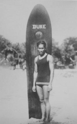 Duke Paoa Kahanamoku with his surfboard-(WC)-c. 1910-1915