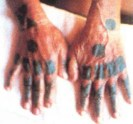 Hajichi tattoos on the back of women's hands-a sign of their status in the society