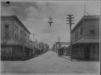 Hilo street scene-L Turner-later-Hilo Drug on left-PP-29-5-016