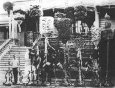 Kamehameha family kāhili assembled in front of Keōua Hale, the house of Keʻelikōlani and Bernice P. Bishop, c.1890.