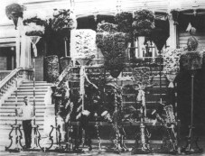Kamehameha family kāhili assembled in front of Keōua Hale, the house of Keʻelikōlani and Bernice P. Bishop, c.1890.