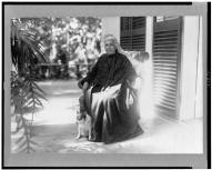 Liliuokalani, Queen of Hawaii, full-length portrait, seated, outdoors, with dog, facing slightly left-LOC-3c05894v
