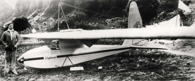 "Lt. William A. Cocke of Wheeler's 19th Pursuit Squadron by ""Nighthawk"" glider in which he broke the official world record of 14 hours & 7 min. Note unofficial 19th Pursuit Squadron insignia on tail of glider."