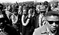 Martin Luther King others wearing lei Selma to Montgomery on March 22, 1965