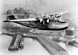 Pan Am China Clipper, leaves San Francisco Bay for Manila carrying the first United States trans-Pacific air mail on Nov. 22, 1935
