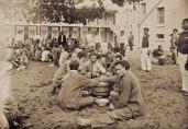 Prison_Inmates_around_Communal_Buckets_of_Poi