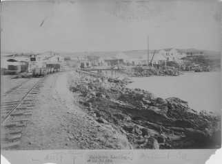 Railroad tracks and harbor at Mahukona Landing, Kohala, Hawaii-(HSA)-PP-88-3-025-1882