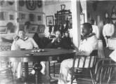 Robert_Louis_Stevenson,_Lloyd_Osbourne,_and_Kalakaua_in_the_King's_boathouse_(PP-96-14-011)