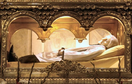 Saint John Mary Vianney (wax mask) entombed above the main altar in the Basilica at Ars, France