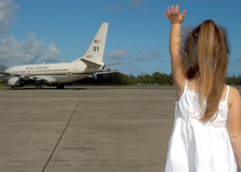 """041127-N-3019M-004 Marine Corps Air Base Kaneohe, Hawaii (Nov. 27, 2004) - A family member of a Sailor assigned to the """"Skinny Dragons"""" of Patrol Squadron Four (VP-4), waves goodbye to her father as he departs aboard an C-40A Clipper assigned to the """"Lonestar Express"""" of Fleet Logistics Support Squadron Five Nine (VR-59) for a scheduled deployment to the 5th and 7th Fleet areas of operations in the Western Pacific. A total of 390 Sailors from VP-4 are scheduled to deploy over the next week in support of Operations Iraqi Freedom (OIF). U.S. Navy photo by Journalist 3rd Class Ryan C. McGinley (RELEASED)"""