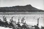 Waikiki Beach behind barbed wire fence, during martial law