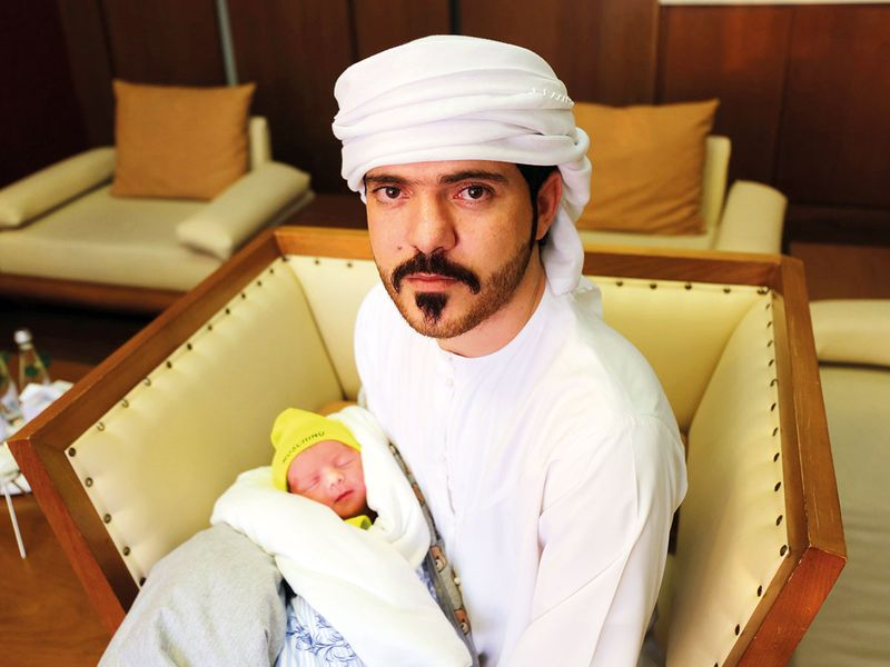 Mohammad Yasser Al Shaikh with his baby Ali
