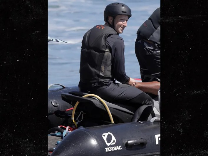 Facebook CEO captured surfing with ankle bracelet that drives sharks away