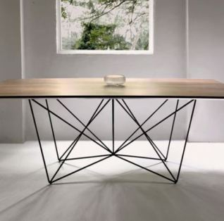 http://designismymuse.tumblr.com/post/3496185903/traversa-table-by-felix-low-for-foundry-collection