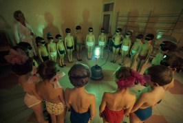 Children circle around an ultraviolet lamp to get a dose of vitamin D in Murmansk, Union of Soviet Socialist Republics, August 1977