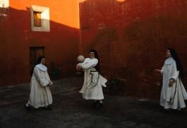 Novice nuns play ball at the Santa Catalina Monestary in Arequipa, Peru, 1998.