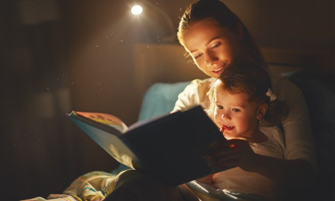 Barry-Brunswick-Parents-Reading-to-Child-at-Bedtime
