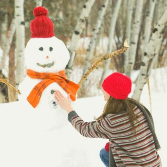 building a snowman is a fun thing to do this christmas