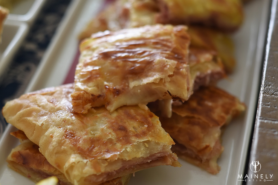 Buttery flaky puff pastry with melty gruyere, tuscan ham and caramelized onions