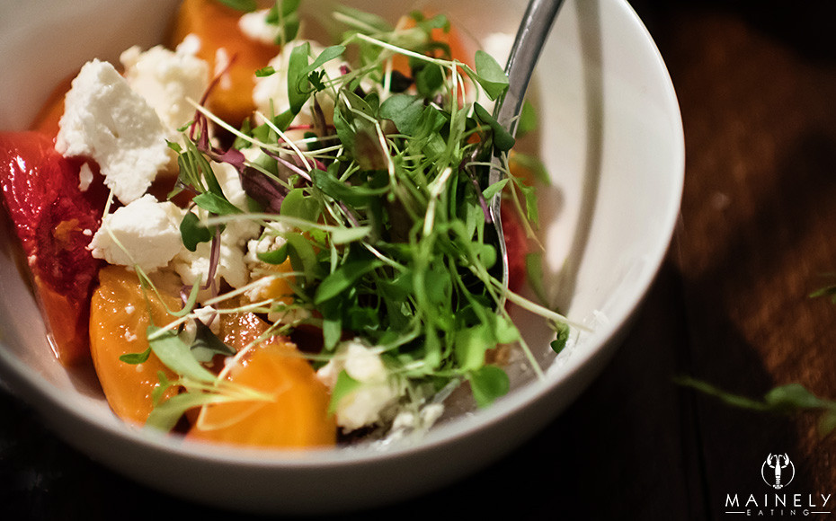 A healthy salad bowl with roast beets, crumbled goat cheese and baby greens