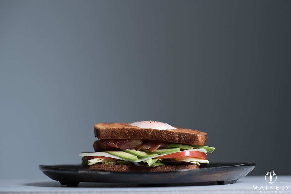 Piled-high BLT with avocado, cheese and runny yolk egg-in-the-hole