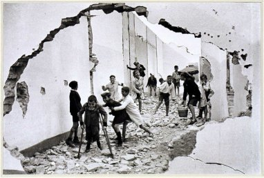 Henri Cartier-Bresson, Young boys playing in rubble. Sevilla, Andalucia. 1933 @Henri Cartier-Bresson   Magnum Photos