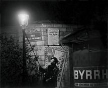 Extinguishing a streetlight on Rue Émile Richard, c. 1932 @ Brassai, Paris