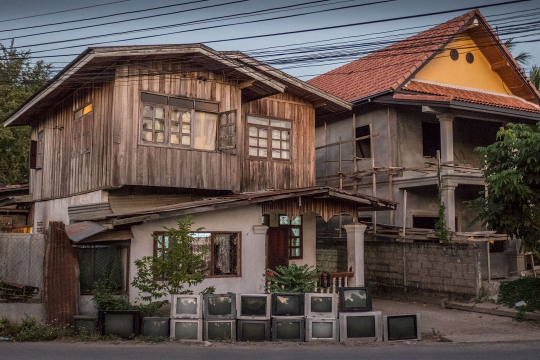 TVs in front of a Lao house in Luang Prabang Laos