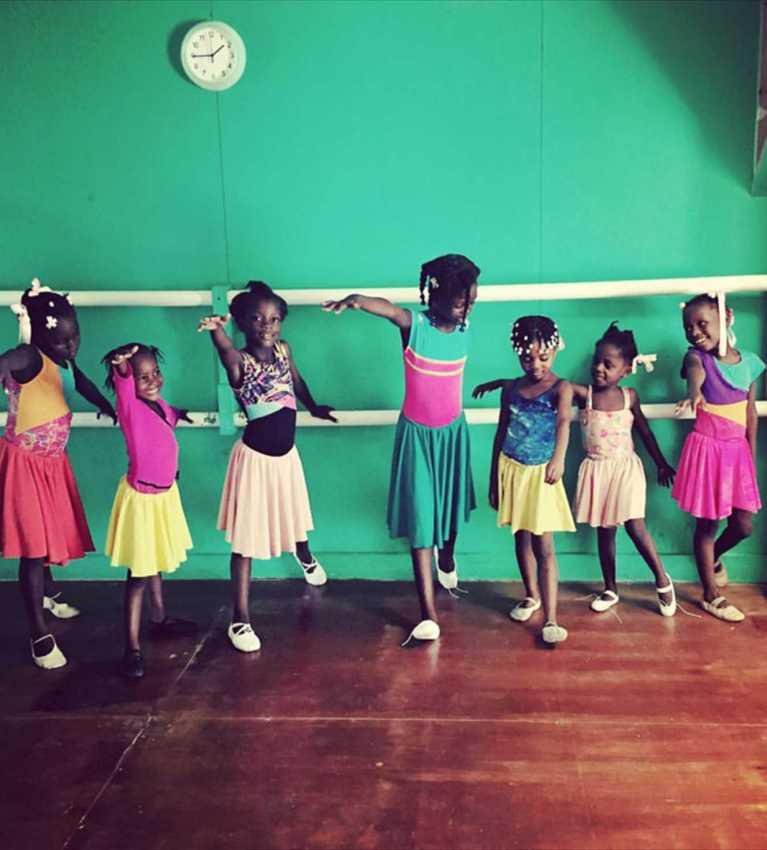 Milk Carton on a String kids dancing in Haiti